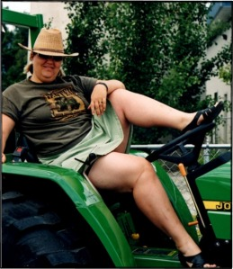 Shelby on a tractor