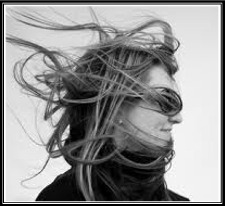 woman's hair blowing crazy in the wind